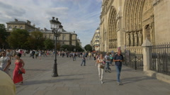 People of all ages visiting the Notre-Dame de Paris Stock Footage