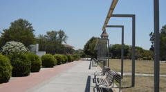 Empty Park Benches By Monument Stock Footage