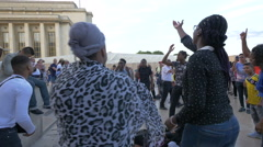 African tourists dancing, singing and clapping at Trocadero esplanade, Paris - stock footage