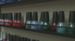 Rack of Nail Polish Bottles in Salon Stock Footage