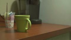 Man Knocks Over Coffee Mug Stock Footage
