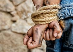 Prisoner bound with rope Stock Photos