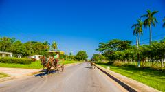CENTRAL ROAD, CUBA - SEPTEMBER 06, 2015: Horse and a cart on a street in rural - stock photo