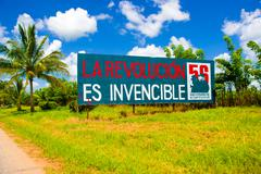 Stock Photo of CENTRAL ROAD, CUBA - SEPTEMBER 06, 2015: Communist propaganda billboard in the