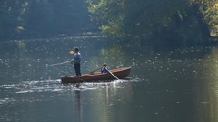 Father and son fishing together on lake - stock footage