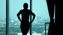 Businesswoman admire view from window in office, slow motion 240fps - stock footage