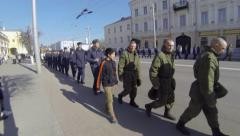 Column of Russian military people walking along provincial city, Vladimir Stock Footage
