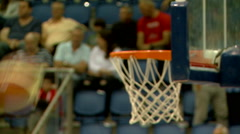 Basketball. Inserted the basket in the end of attack at a basketball game Stock Footage