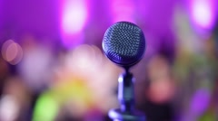 Microphone on a stage with blurred audience in front, taken from stage Stock Footage