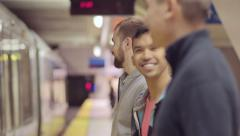 Gay Couples Chat While They Wait For Their Subway Train To Pull Up To Platform Stock Footage