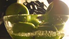 Washing green apples in a glass bowl, slow motion video Stock Footage