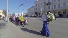 Children walking on traditional Russian orthodox ceremony, bouquets of flowers, Stock Footage