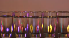 alcohol glasses with party lamps background - stock footage