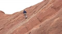 Man repelling on redrock in southern utah - stock footage