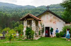 St. Nicholas Church and belfry, monastery Moraca, Montenegro - stock photo