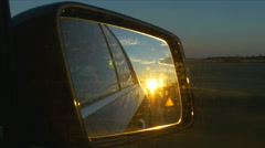 Sunset Lens Flare In Car Mirror Refection Road Traffic Driving Hand Held Stock Footage