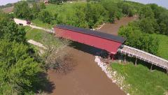 Aerial approach to covered bridge in Madison county Stock Footage