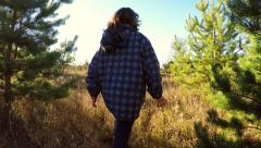 Young girl running between the trees. Autumn season Stock Footage