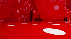 White dots on red background - an interesting exhibition Stock Footage