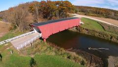 Aerial view of Hogback covered bridge in Fall colors Stock Footage