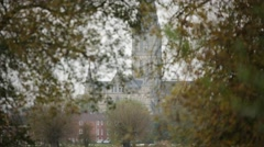 Salisbury Cathedral in the golden trees, European Cathedral Stock Footage
