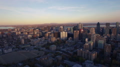 4K aerial drone shot of montreal skyline at sunset backward move Stock Footage