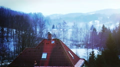 4K Grim time lapse footage: a house in the mountains with the smoking chimney Stock Footage