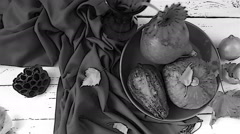 Black and white footage of an autumnal still life being set up Stock Footage
