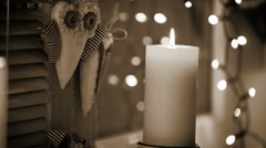 Black and white sepia toned footage of a Christmas candle burning Stock Footage