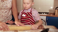 Mother and her little helper in the process of making a cake Stock Footage