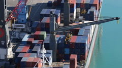 Crane unloading containers off ship Stock Footage