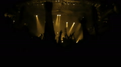 Slow motion video of cheering crowd during rock-concert - stock footage