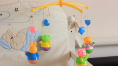 toys above the baby crib - stock footage