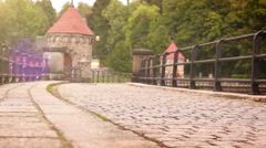 A man promenading along the cobbled old walkway in the Czech Republic Stock Footage
