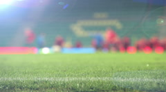 Unfocused footage of footballers (soccer-players) warming up before the match Stock Footage