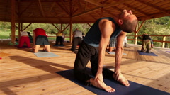 Yoga instructor shows how to do a stretching exercise during the seminar Stock Footage