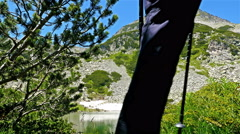 Woman hiker on mountains in Pirin, Bulgaria - Summer Day Stock Footage