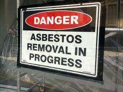 Sign reads: Danger - Asbestos removal in progress Stock Photos