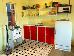 Interior of an old batch holiday home Kitchen in New Zealand. Stock Photos