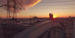 People top historic 6th Street Bridge arches sunset aerial view Los Angeles 4K Stock Footage