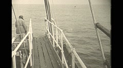 Vintage 16mm film, 1938, whaling, whale pulled to ship Stock Footage