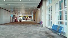 Nearly empty airport terminal Stock Footage