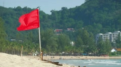 Red Warning Flag over a Tourist Beach in Southeast Asia Stock Footage