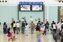People at the arrival hall of an airport - stock photo