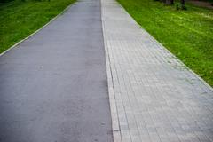 Pathway in the park with green grass Stock Photos