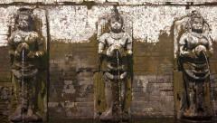 Ancient Stone Fountain Sculptures at Tirta Empul Hindu Temple, Bali, Indonesi Stock Footage