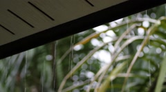 rainwater flows down from the roof - stock footage