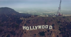 Aerial view of Hollywood Sign on top of Mount Lee on a gloomy day. 4K UHD Stock Footage
