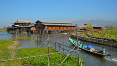 Handmade Tour Boat Navigates Canals on Inle Lake in Myanmar Stock Footage