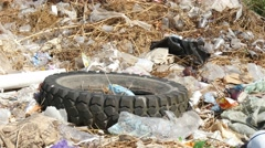 Old Tire On The Landfill Stock Footage